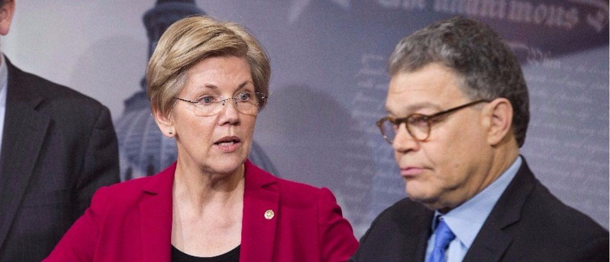 Sen. Elizabeth Warren (D-MA) and Sen. Al Franken (D-MN). REUTERS/Joshua Roberts.