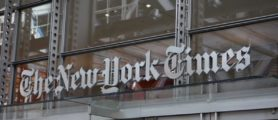 The sign over the west entrance of the New York Times building at 620 Eighth Ave. April 28, 2016 in New York. / AFP / DON EMMERT        (Photo credit should read DON EMMERT/AFP/Getty Images)