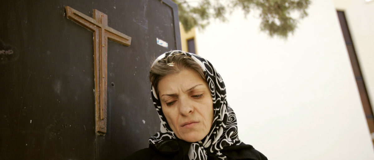 An Iranian Christian woman leaves a church after a prayer ceremony in Tehran September 17, 2006. REUTERS/Morteza Nikoubazl(IRAN) - RTR1HEXU