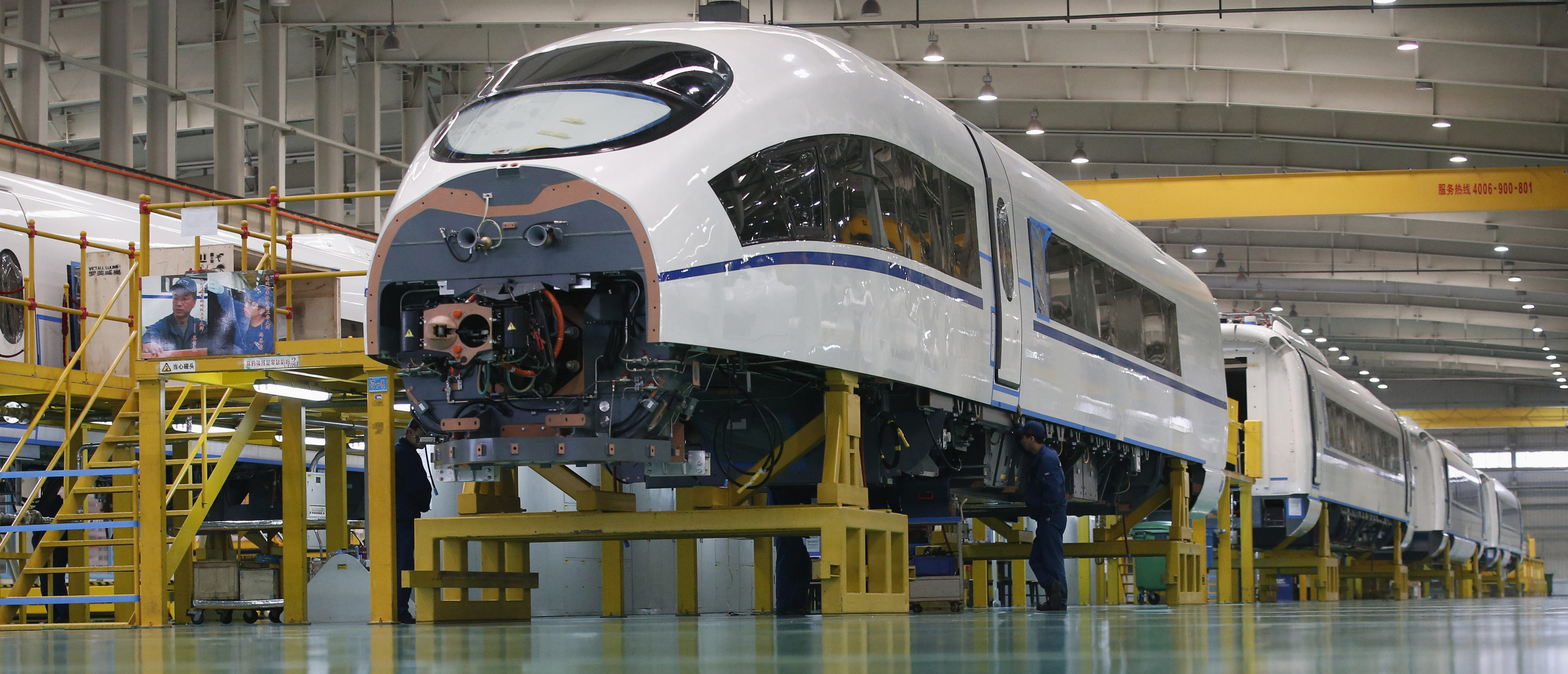 An employee works on a high speed train model CRH380B at a final assembly line of China CNR's Tangshan Railway Vehicle's factory in Tangshan, Hebei province, February 11, 2015. China is in talks with 28 countries including the United States, Russia and Brazil about high-speed rail projects, state-backed trainmaker China CNR said on Wednesday. REUTERS/Kim Kyung-Hoon