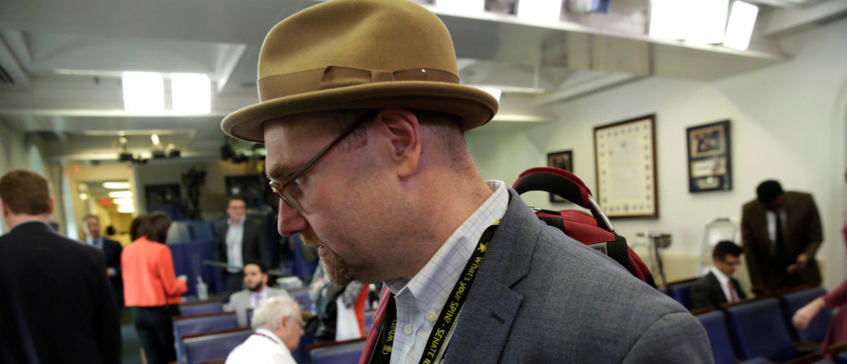"""Glenn Thrush, chief White House political correspondent for the The New York Times, works in the briefing room after being excluded from an off camera """"gaggle"""" meeting at the White House in Washington, U.S., February 24, 2017. REUTERS/Yuri Gripas"""