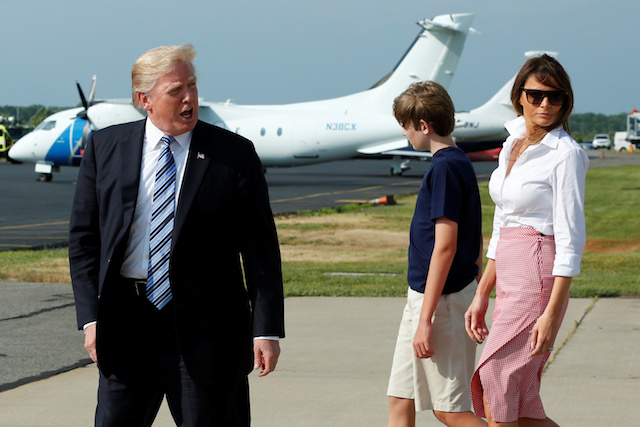 U.S. President Donald Trump with First Lady Melania Trump and their son Barron arrive at Morristown municipal airport, New Jersey, U.S., to spend a weekend at the Trump National Golf Club in Bedminster, New Jersey, June 30, 2017. REUTERS/Yuri Gripas - RTS19BOE