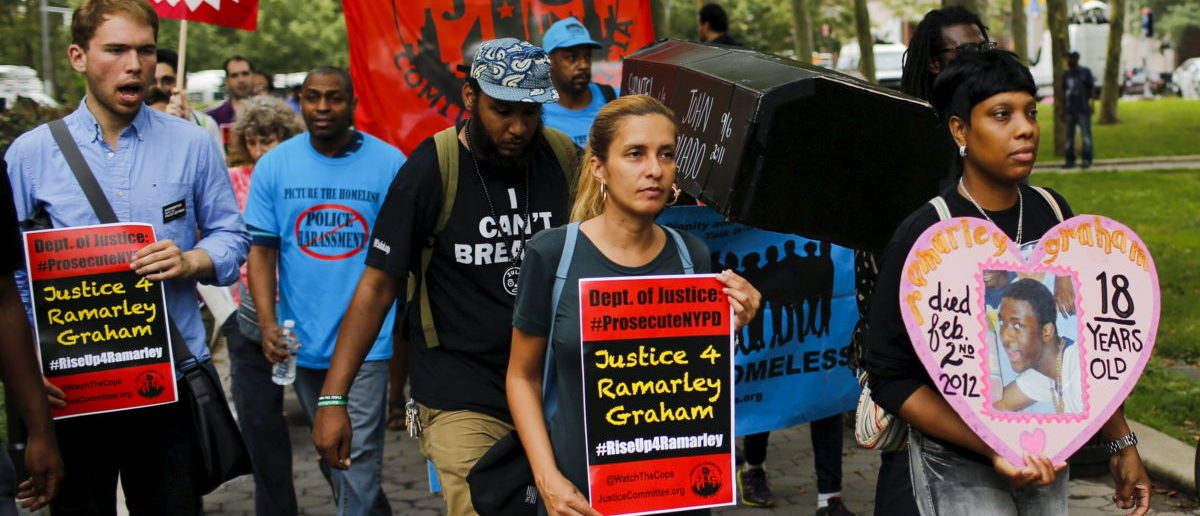 Protesters carry symbolic caskets of people killed by police during a rally for Eric Garner near the Brooklyn court in New York July 18, 2015. Family and supporters marked the anniversary of the police killing of Eric Garner with rallies and vigils demanding police reforms and justice in the controversial case. Protesters gathered on Staten Island, the New York City borough where Garner, a 43-year-old black father of six, died last July 17 after New York police put him in a banned chokehold. REUTERS/Eduardo Munoz