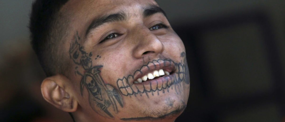 An inmate with a tattoo of Santa Muerte (The Saint of Death) reacts in the Topo Chico prison, during a media tour, in Monterrey, Mexico, February 17, 2016. The director of the prison in northeast Mexico where 49 people died in a riot which took place on February 11, 2016, was accused of murder and detained, along with two others, a state prosecutor said on Saturday. Picture taken February 17. REUTERS/Daniel Becerril - RTX27LSN