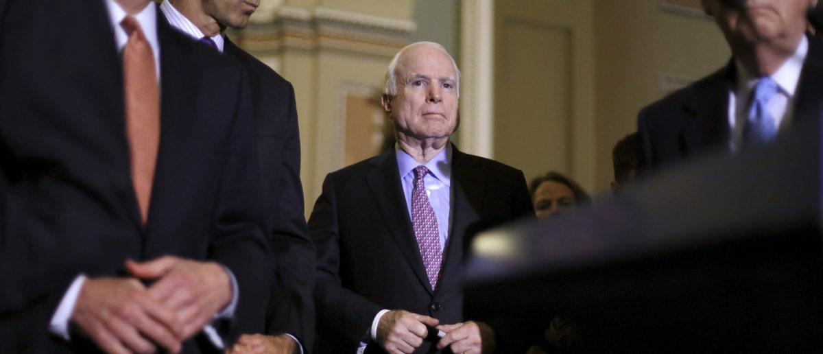 U.S. Senator John McCain (R-AZ) (C) joins Senate Majority Leader Mitch McConnell (R-KY) (R) and other members of the Republican leadership to make comments on military authorization legislation to reporters after the weekly Senate Republican caucus luncheon at the U.S. Capitol in Washington June 16, 2015. REUTERS/Jonathan Ernst/File Photo