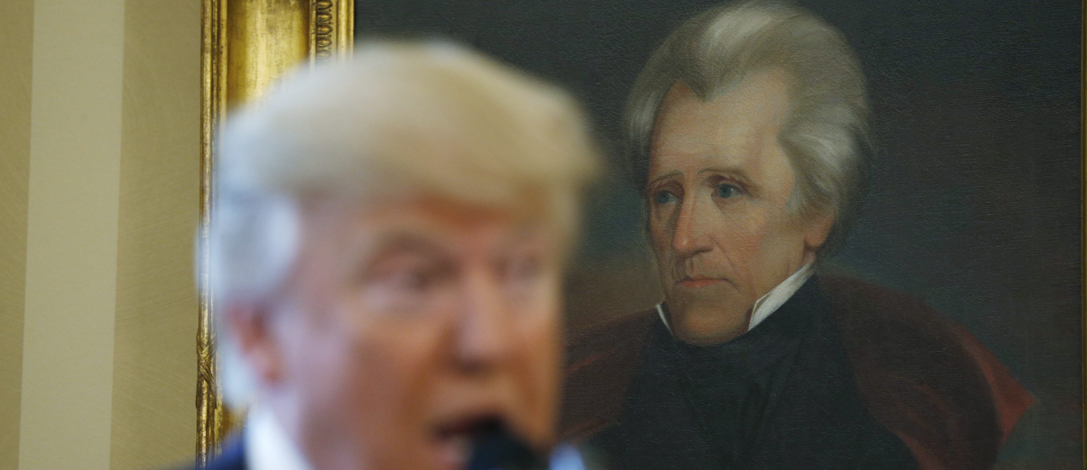 U.S. President Donald Trump speaks in front of a portrait of former U.S. President Andrew Jackson during a swearing-in ceremony for new Attorney General Jeff Sessions at the White House in Washington, U.S., February 9, 2017. REUTERS/Kevin Lamarque - RTX30C1N