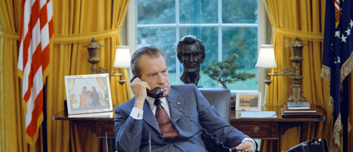 U.S. President Richard Nixon seated at his desk, with family photos and the Lincoln bust statuette visible behind him, in the White House Oval Office in Washington, U.S. on June 23, 1972. Courtesy The Nixon Library and Museum/Handout via REUTERS ATTENTION EDITORS - THIS IMAGE WAS PROVIDED BY A THIRD PARTY. EDITORIAL USE ONLY. - RTX363X4
