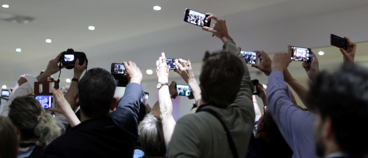 """70th Cannes Film Festival - Photocall for the film """"The Meyerowitz Stories"""" (New and Selected) in competition - Cannes, France. 21/05/2017. Cinema fans and reporters use thir mobile phones before the news conference. REUTERS/Eric Gaillard"""