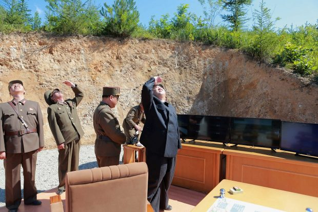 North Korean leader Kim Jong Un looks on during the test-launch of the intercontinental ballistic missile Hwasong-14 in this undated photo released by North Korea's Korean Central News Agency (KCNA) in Pyongyang July 5, 2017. KCNA/via REUTERS