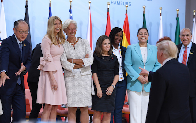 "US President Donald Trump (2nd R) jokes as his daughter Ivanka Trump (2nd L) poses with participants of the panel discussion ""Launch Event Women's Entrepreneur Finance Initiative"" on the second day of the G20 Summit in Hamburg, Germany, July 8, 2017. REUTERS/Patrik STOLLARZ/Pool - RTX3AM7N"
