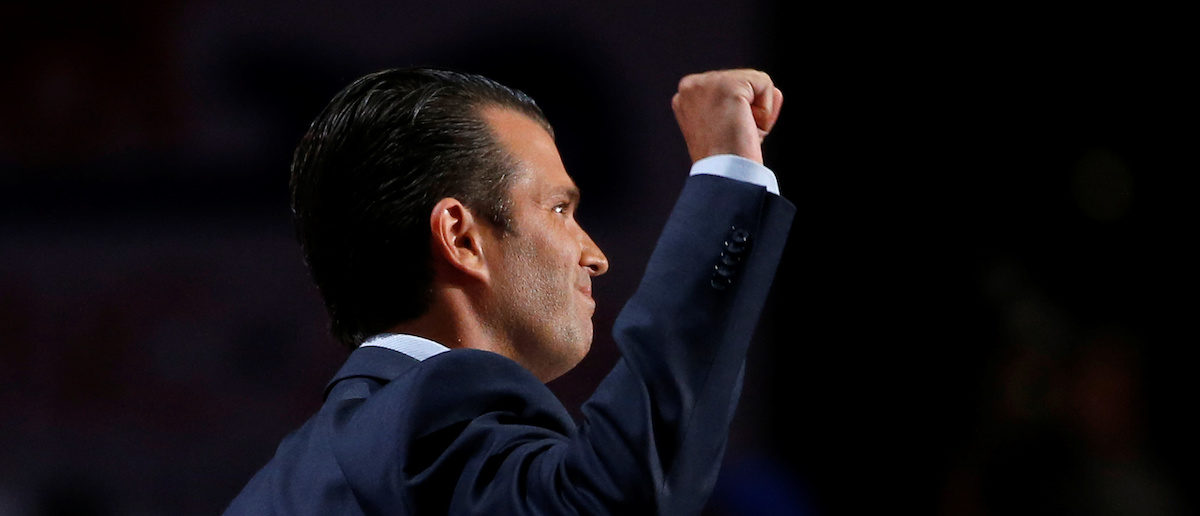 FILE PHOTO: Donald Trump Jr. thrusts his fist after speaking at the 2016 Republican National Convention in Cleveland, Ohio U.S. July 19, 2016.  REUTERS/Mario Anzuoni/File photo - RTX3AWEC