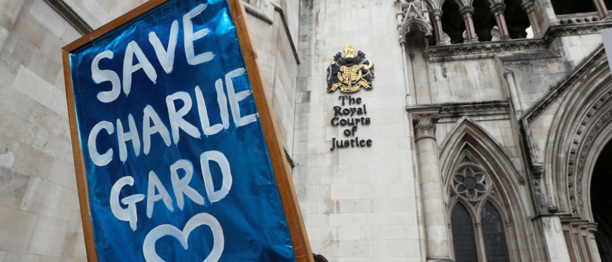 People campaign to show support for allowing Charlie Gard to travel to the United Stated to receive further treatment, outside the High Court in London, Britain July 13, 2017. REUTERS/Peter Nicholls - RTX3B9EC