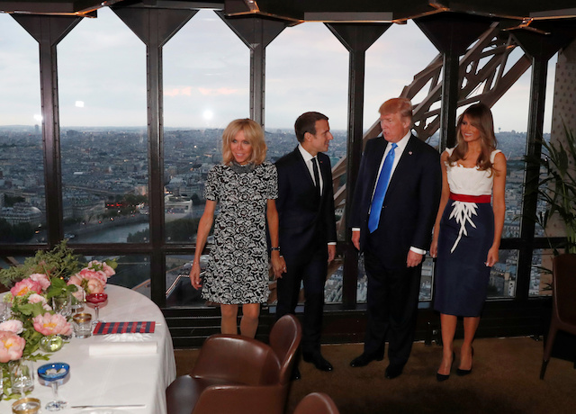 From L-R, Brigitte Macron, wife of French President Emmanuel Macron, U.S. President Donald Trump and First lady Melania Trump pose at the Jules Verne restaurant before a private dinner at the Eiffel Tower in Paris, France, July 13, 2107. REUTERS/Yves Herman - RTX3BD2W