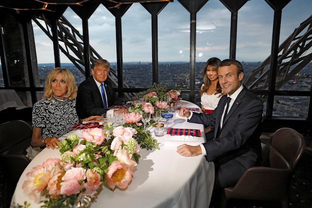Brigitte Macron (L), wife of French President Emmanuel Macron (R), U.S. President Donald Trump (2ndL) and First lady Melania Trump pose at their table at the Jules Verne restaurant for a private dinner at the Eiffel Tower in Paris, France, July 13, 2107. REUTERS/Kevin Lamarque TPX IMAGES OF THE DAY - RTX3BD3T