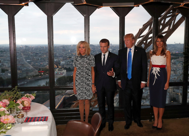 From L-R, Brigitte Macron, wife of French President Emmanuel Macron, U.S. President Donald Trump and First lady Melania Trump pose at the Jules Verne restaurant before a private dinner at the Eiffel Tower in Paris, France, July 13, 2107. REUTERS/Yves Herman - RTX3BD4M