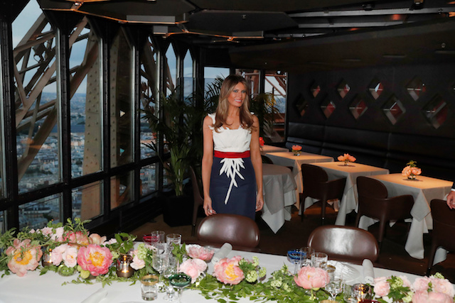 U.S. First lady Melania Trump smiles at the Jules Verne restaurant before a private dinner at the Eiffel Tower in Paris, France, July 13, 2107. REUTERS/Kevin Lamarque - RTX3BD6B