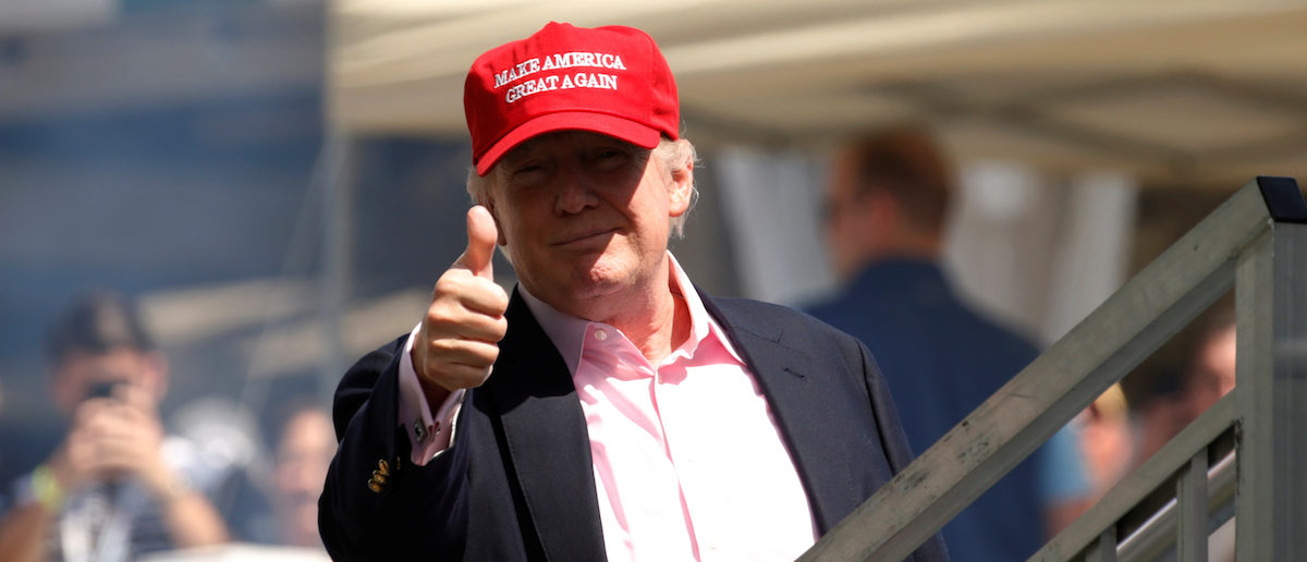 U.S. President Donald Trump gives a thumbs up to supporters as he arrives at the U.S. Women's Open golf tournament at Trump National Golf Club in Bedminster, New Jersey, U.S., July 16, 2017. REUTERS/Kevin Lamarque - RTX3BP5P