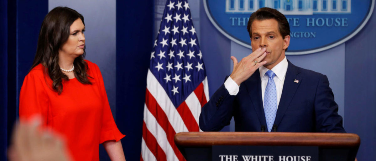 New White house Communications Director Anthony Scaramucci (R)), flanked by White House Press Secretary Sarah Sanders, blows a kiss to reporters after addressing the daily briefing at the White House in Washington, U.S. July 21, 2017. REUTERS/Jonathan Ernst