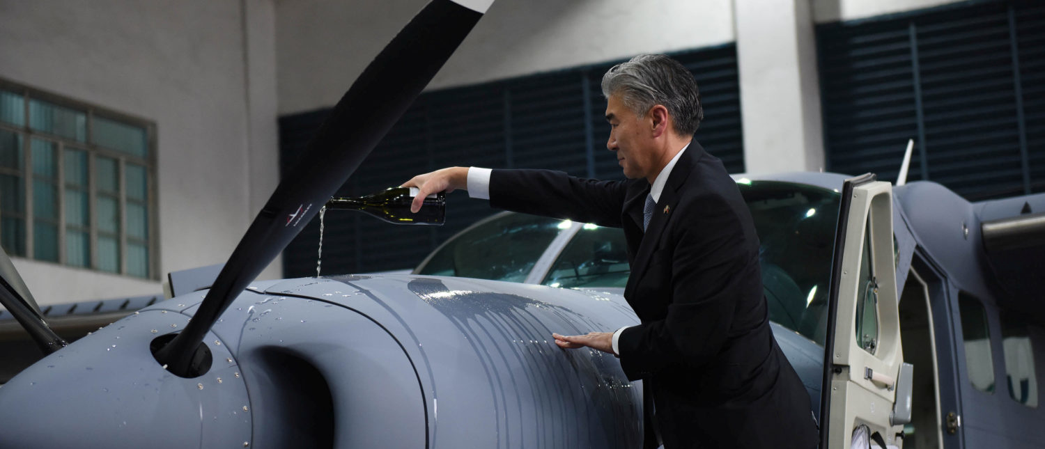 U.S. Ambassador to the Philippines Sung Kim pours wine on a Cessna-208B Grand Caravan Intelligence, Surveillance and Reconnaissance (ISR) aircraft acquired by the Philippine government from the U.S. during a turn over ceremony at the Philippine Air Force (PAF) headquarters in Manila, Philippines July 27, 2017. REUTERS/Dondi Tawatao