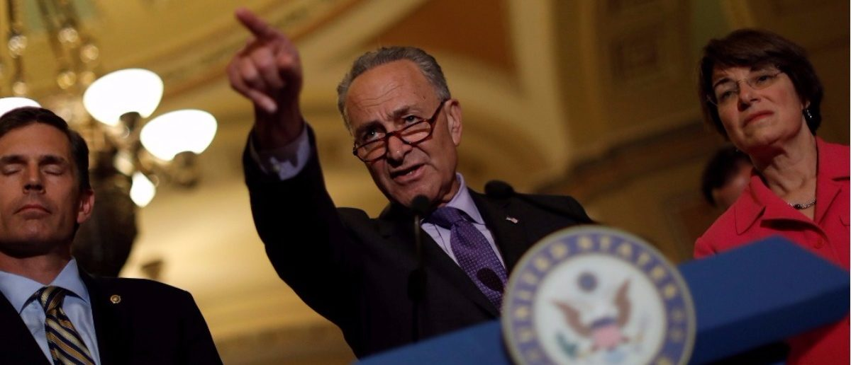 Senate Minority Leader Chuck Schumer speaks with the media about the recently withdrawn healthcare bill on Capitol Hill in Washington, U.S., July 18, 2017. REUTERS/Aaron P. Bernstein.