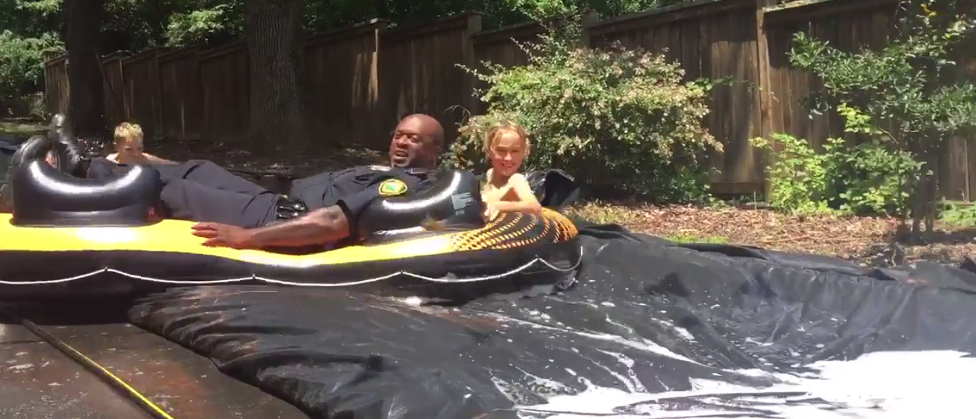 Officers in North Carolina use a homemade slip-n-slide (Screenshot/Facebook video)