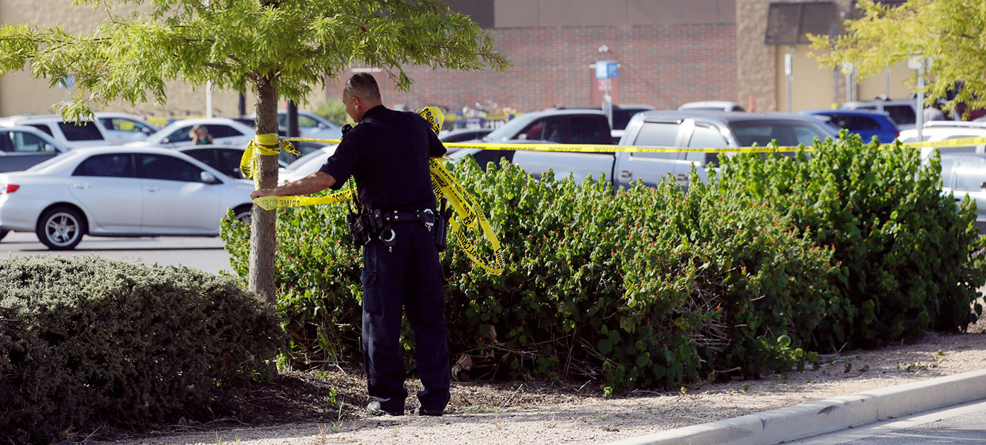 A police officer works on a crime scene after eight people believed to be illegal immigrants being smuggled into the United States were found dead inside a sweltering 18-wheeler trailer parked behind a Walmart store in San Antonio, Texas, U.S. July 23, 2017. (PHOTO: REUTERS/Ray Whitehouse)