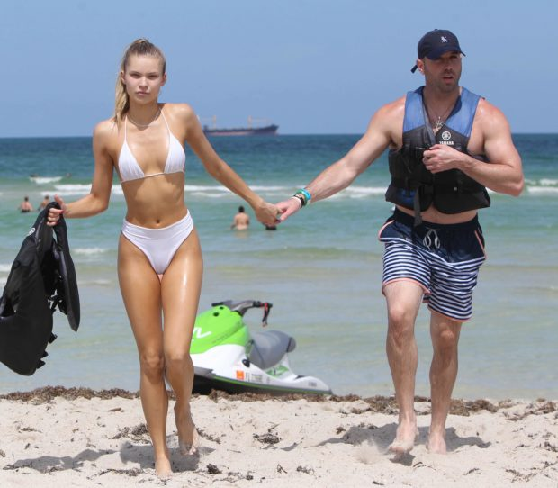 Baseball player Jose Canseco's daughter Josie Canseco wore a high cut bikini while in company of boyfriend in Miami Beach (Credit: Splash News)