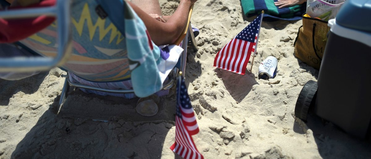 U.S. flags are displayed on the beach in Seaside Park, New Jersey, U.S. July 3, 2017. REUTERS/Mark Makela