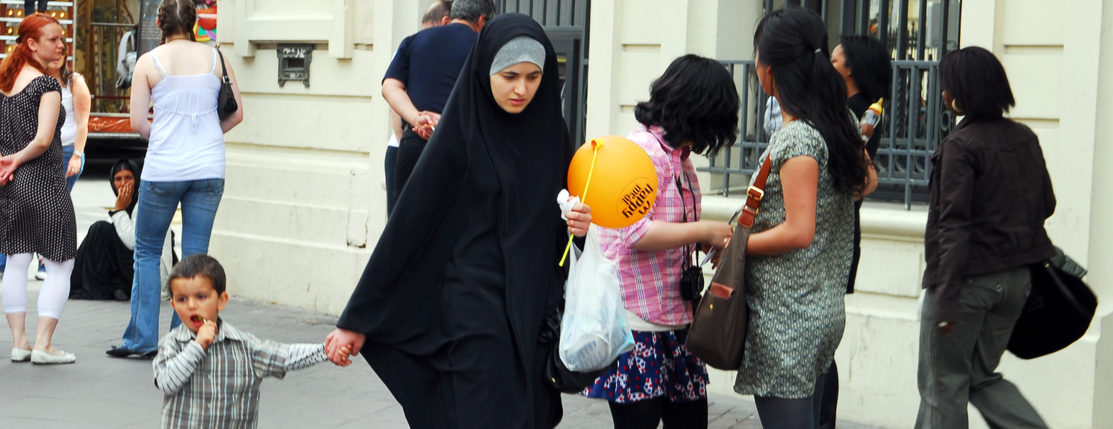 Shutterstock/ MARSEILLE - MAY 10 2008:Muslim woman wearing hijab in Marseille,France.Since 2011 it is illegal to wear a face-covering veil or other mask in public places such as street, public transport and parks.