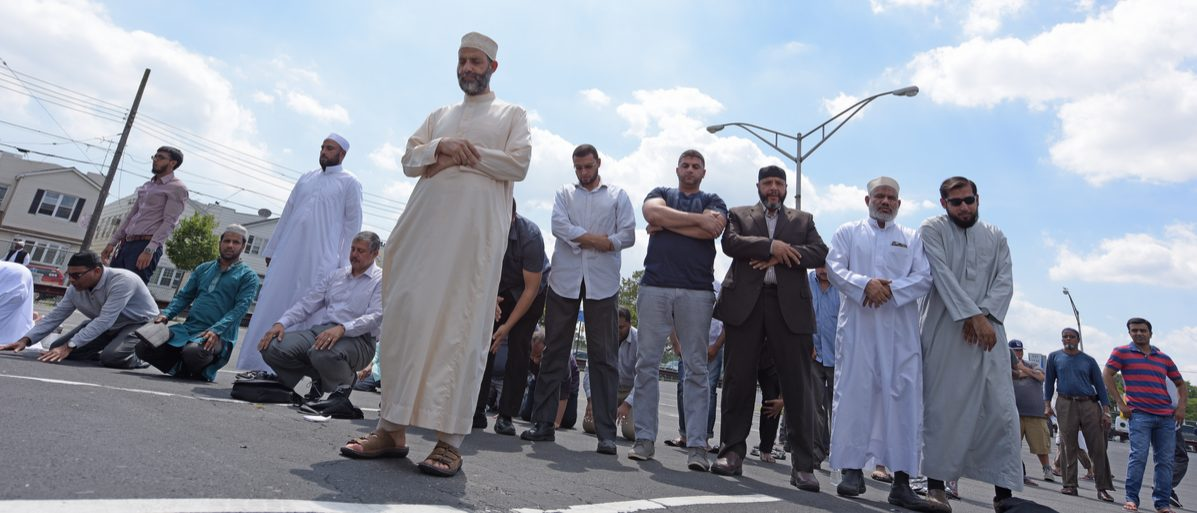 Shutterstock/ NEW YORK CITY - AUGUST 15 2016: The Muslim community held a memorial service for slain Imam Maulano Akojee & Thara Uddin in East New York followed by a march to Ozone Park, Queens