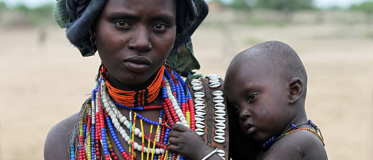 Shutterstock/ SOUTH ETHIOPIA, AFRICA - DEC 27, 2009 Unidentified Mother and her son - Arbore tribe