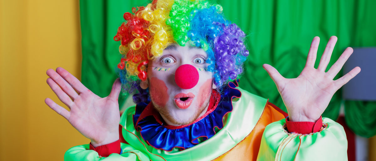 Clown with queer expression on his face. Shutterstock/ Nomad_Soul