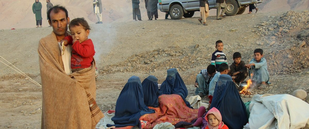 An Afghan family waits for help from the government and aid organizations in Takhar