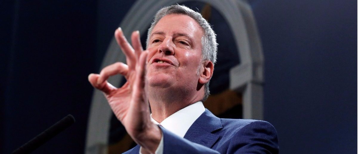 New York Mayor Bill de Blasio speaks regarding the U.S. President Donald Trump's federal budget proposal with New York Police Department Commissioner James O'Neill (L) at city hall in New York, U.S., March 16, 2017. REUTERS/Lucas Jackson