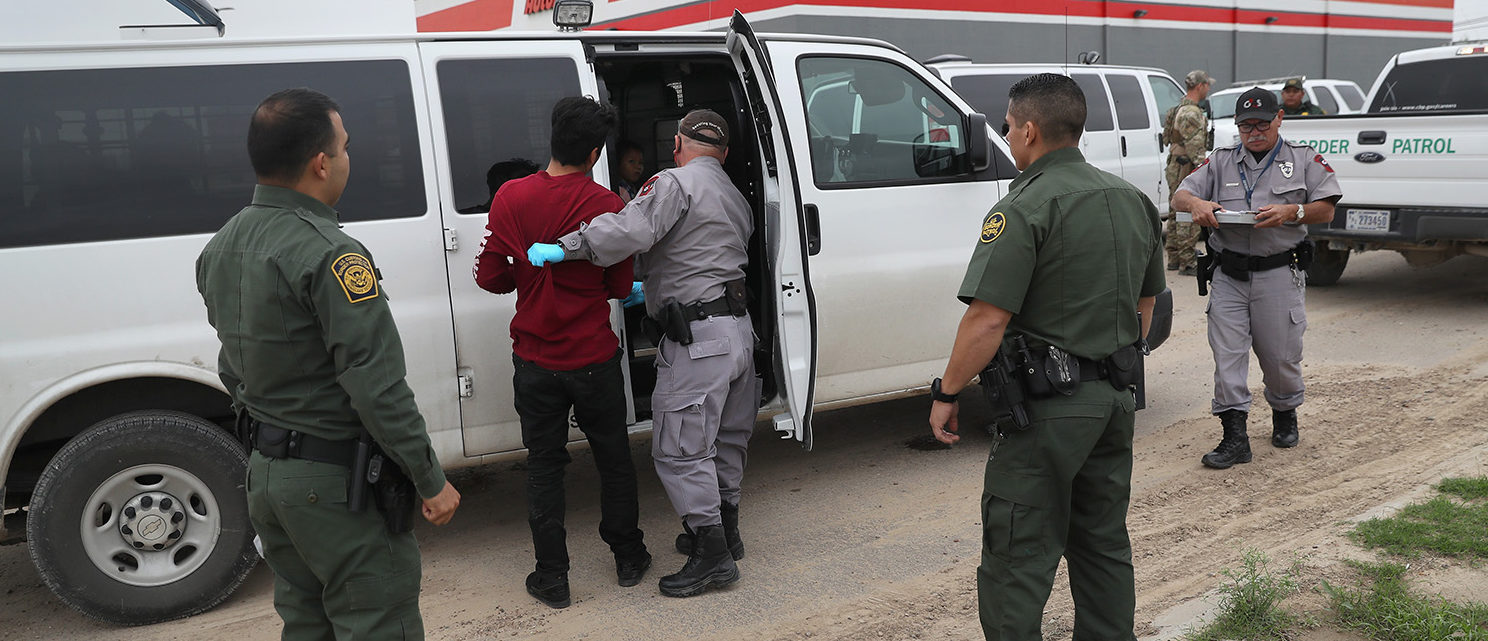 U.S. border officials detain an undocumented immigrant caught near the U.S.-Mexico border on March 13, 2017 in Roma, Texas. The Border Patrol has reported that illegal crossings from Mexico have dropped some 40 percent along the southwest border since Donald Trump took office.  (Photo by John Moore/Getty Images)