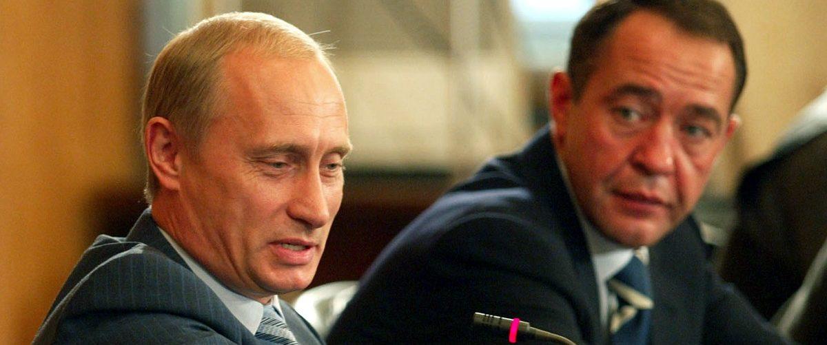 Vladimir Putin and Mikhail Lesin