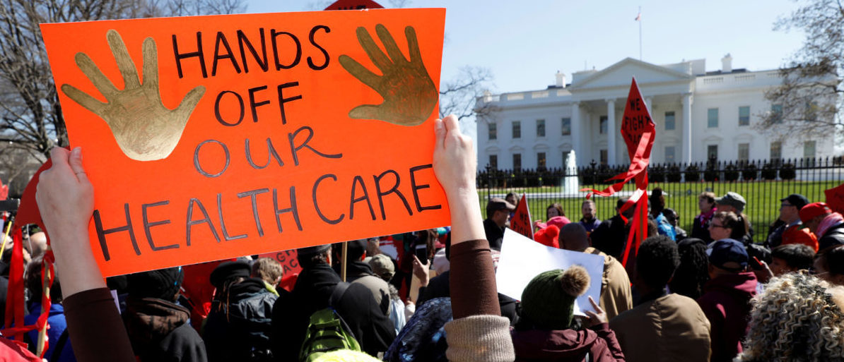 Protesters demonstrate against U.S. President Donald Trump and his plans to end Obamacare outside the White House in Washington, U.S., March 23, 2017. (Photo: REUTERS/Kevin Lamarque - RTX32FLD)