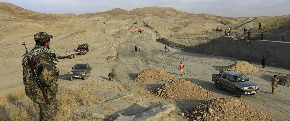 An Afghan security personnel keeps watch at a road construction site, which is being built by a Chinese company, in Khogyani district of Nangarhar province November 19, 2015. A new road linking the Afghan capital with a trade hub near Pakistan has been stuck in the slow lane since a state-owned Chinese company took the contract to build it two years ago, bedevilled by militant attacks and accusations of mismanagement. Picture taken November 19, 2015. REUTERS/Parwiz.