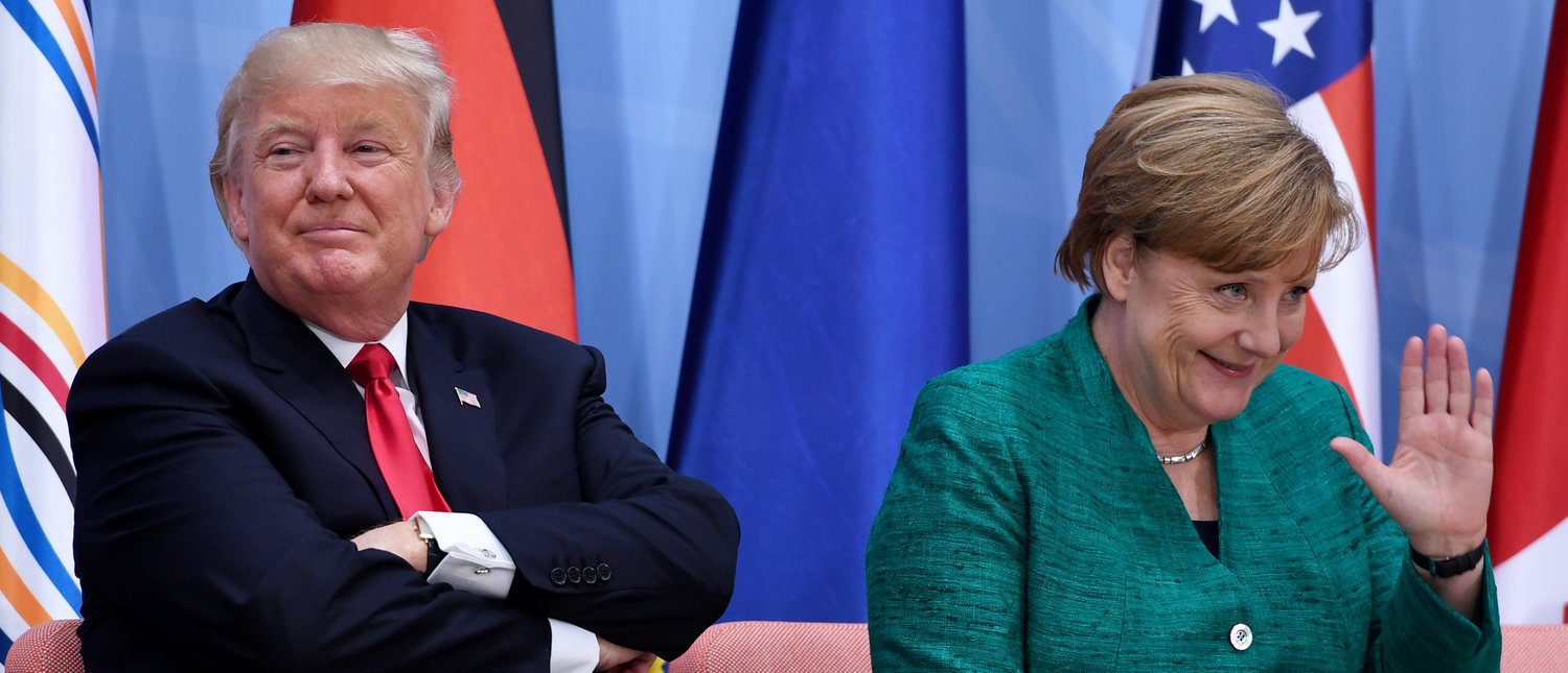 """US President Donald Trump (L) and German Chancellor Angela Merkel attend the panel discussion """"Launch Event Women's Entrepreneur Finance Initiative"""" on the second day of the G20 Summit in Hamburg, Germany, July 8, 2017. (REUTERS/Patrik STOLLARZ/Pool - RTX3AM4K)"""