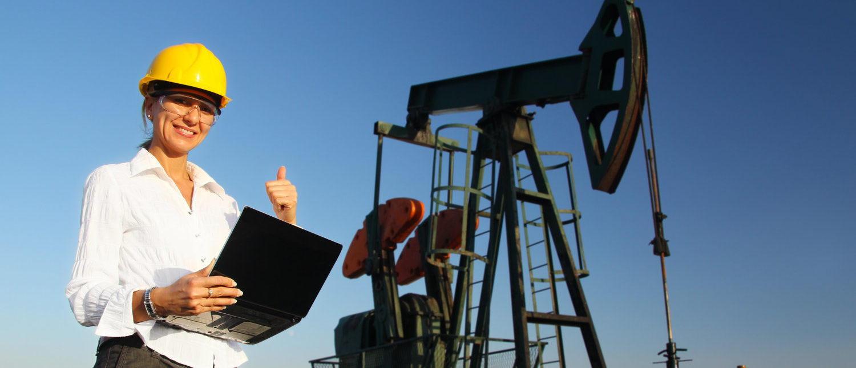 Smiling Female Engineer in an Oilfield (Shutterstock/branislavpudar)