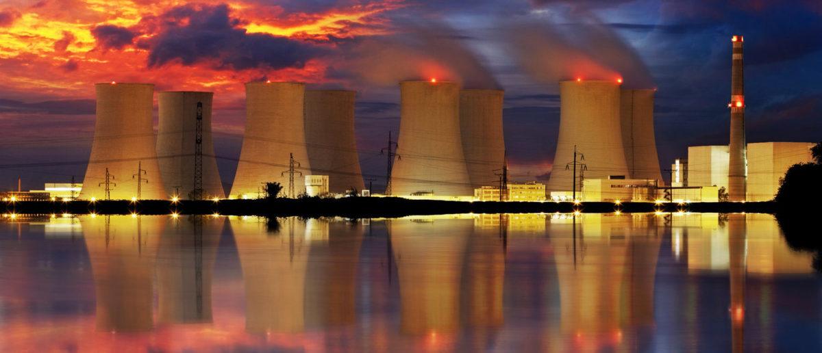 Nuclear power plant by night  (Shutterstock/TTstudio)