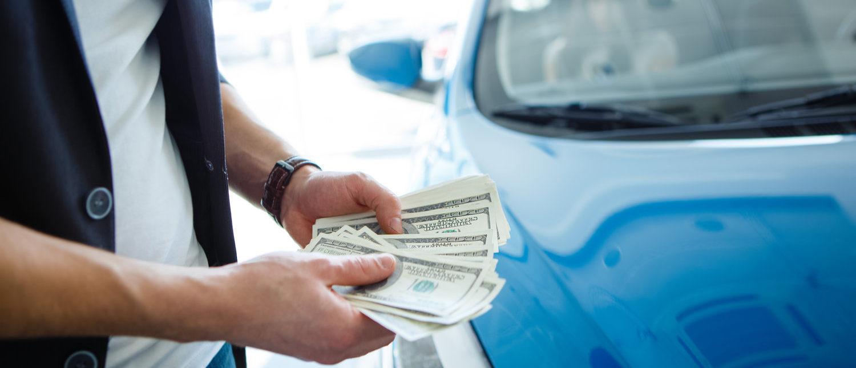 Money in hand (Shutterstock/ Roman Seliutin)