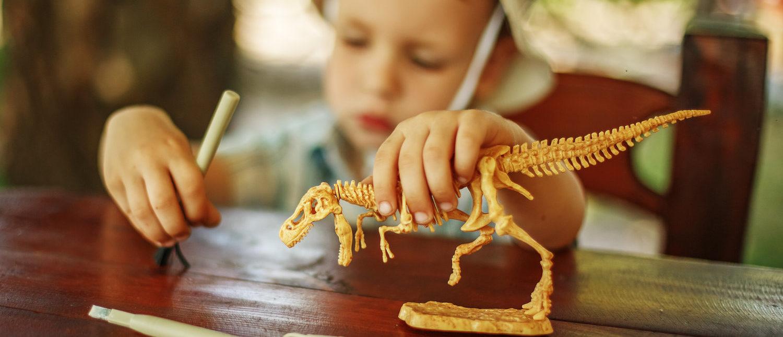 Cute little boy wants to be an archaeologist/paleontologist (Shutterstock/Nataliia Zhekova)
