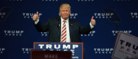 Donald Trump giving the thumbs up gesture as he delivers a campaign speech at Sun Center Studios. (Shutterstock/Evan El-Amin)