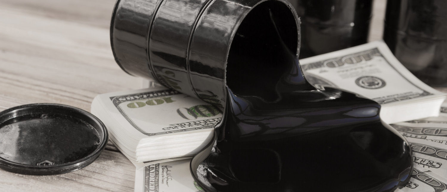 Oil and barrels. poured oil on the money dollar currency. bargaining. Exchange. oil business. Profit growth rates, profit from sales of petroleum products. (Shutterstock/gerasimov_foto_174)
