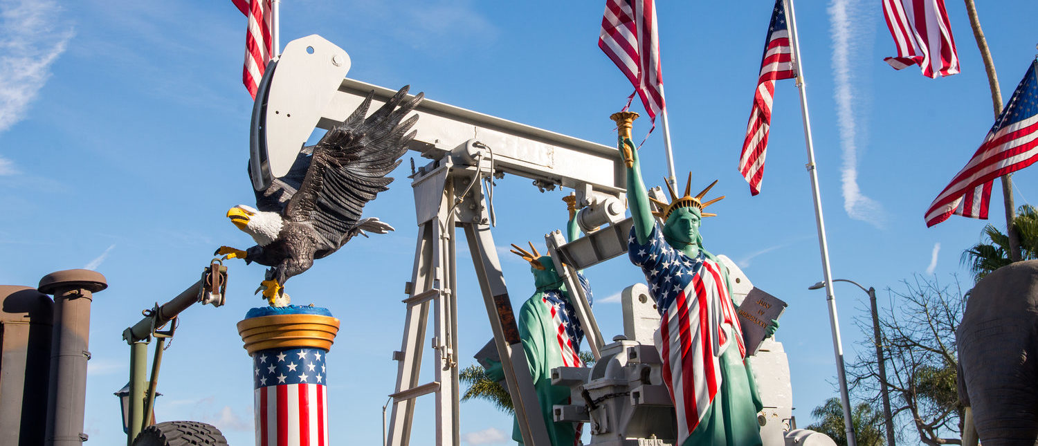 Huntington Beach, California - January 24, 2017. Oil field workers celebrate Donald Trumps victory and partnership with the oil industry by decorating oil pumps with American Flags and statues. (Shutterstock/Steve Bruckmann)
