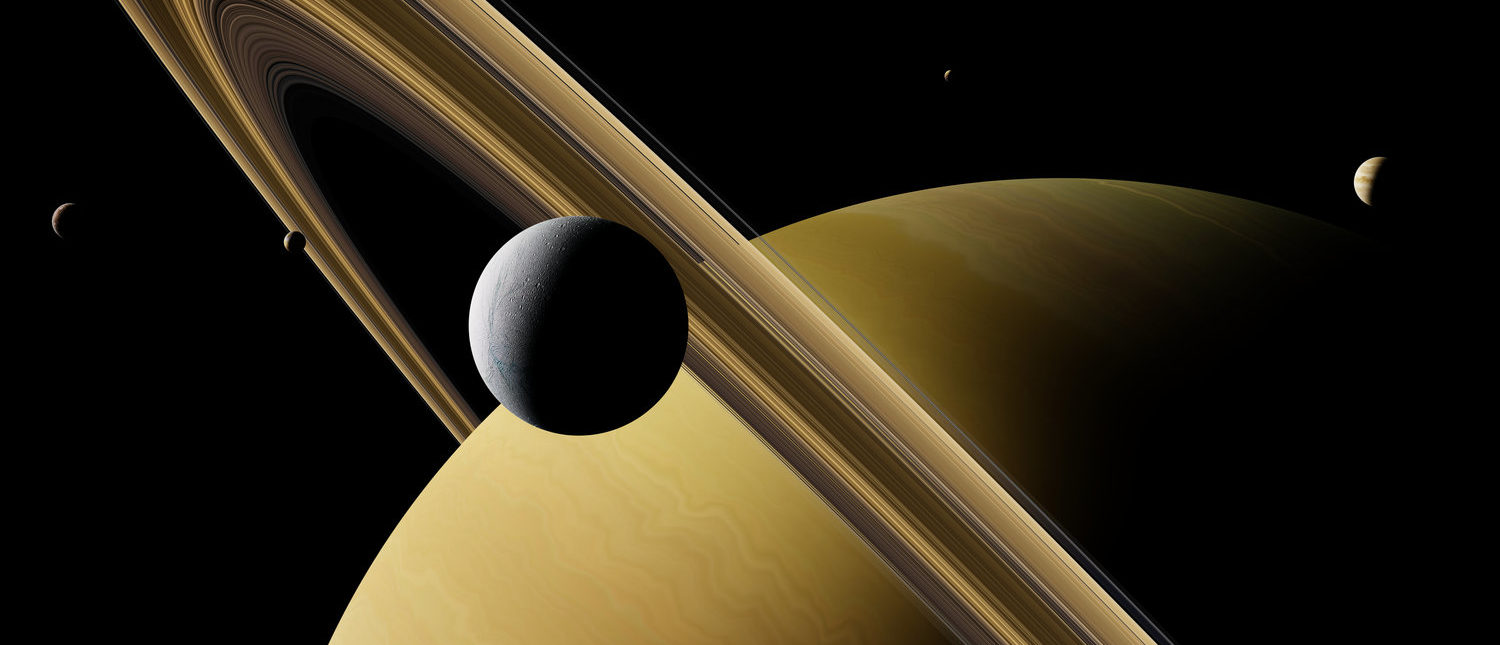 Saturn's moon Enceladus in front of planet Saturn, rings and other moons (3d illustration, elements of this image are furnished by NASA) (Shutterstock/Dotted Yeti)