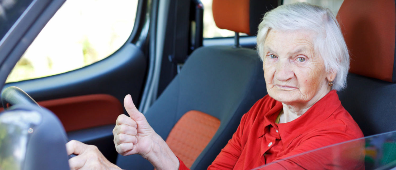 A senior citizen behind the wheel is very confident before she starts to drive.  [Shutterstock - Ocskay Mark]