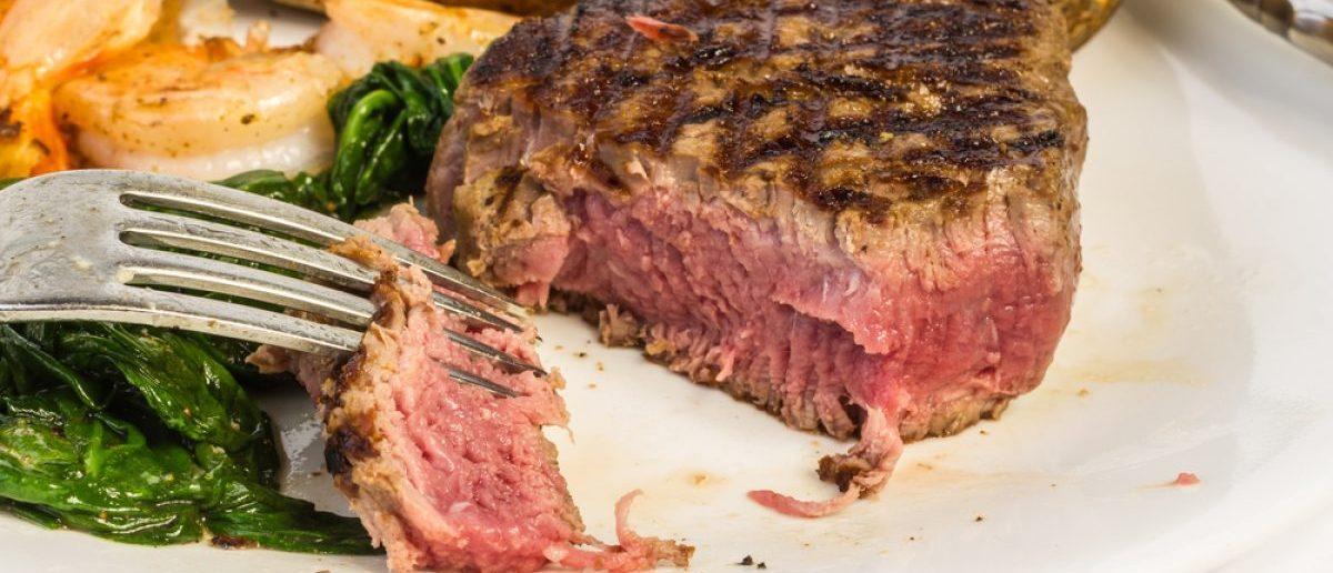 Rare filet mignon steak with several bites taken. [Shutterstock - Warren Price Photography]
