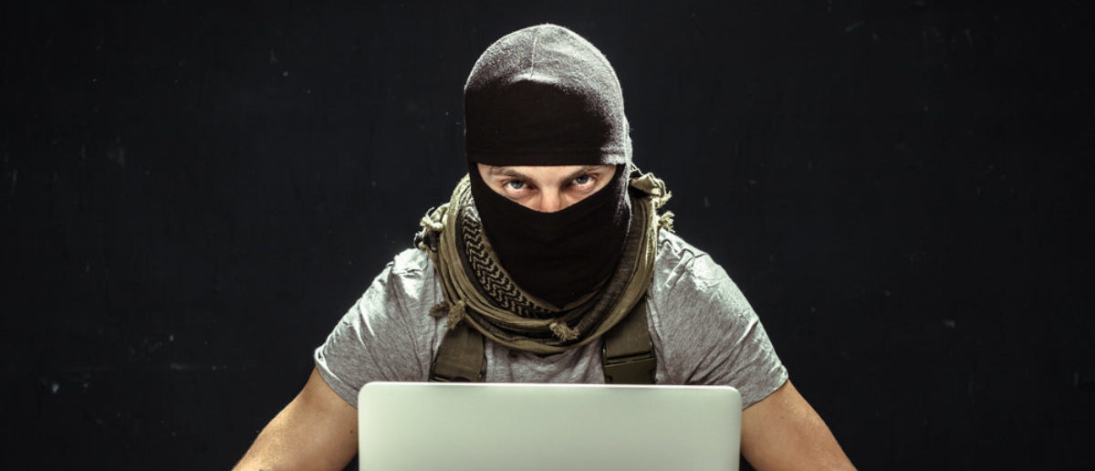 A terrorist works on his computer. Source: FabrikaSimf/Shutterstock